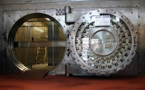 Large door to an old bank vault by jonathunder at http://en.wikipedia.org/wiki/Bank#mediaviewer/File:WinonaSavingsBankVault.JPG.