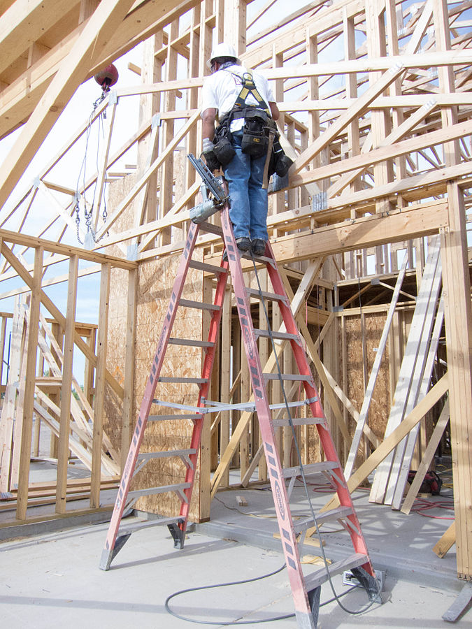 """""""Ladder fall prevention (9253630705)"""" by National Institute for Occupational Safety and Health (NIOSH) from USA - LeBlanc Construction Photos 2012. Licensed under Public Domain via Commons - https://commons.wikimedia.org/wiki/File:Ladder_fall_prevention_(9253630705).jpg#/media/File:Ladder_fall_prevention_(9253630705).jpg"""